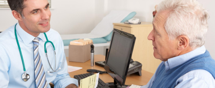 GP in consultation with an elderly patient