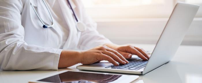 Hospital worker on keyboard
